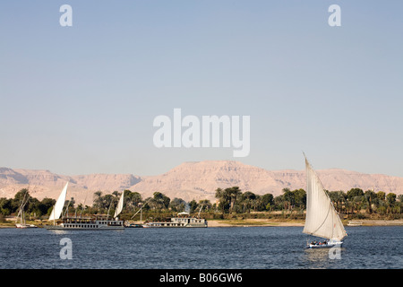 Feluccas sailing on the River Nile at Luxor Egypt - Stock Photo