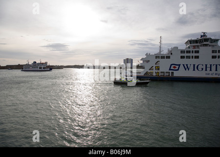 A police launch and two Isle of Wight ferries negotiate Portsmouth Harbour, Hampshire, England. - Stock Photo