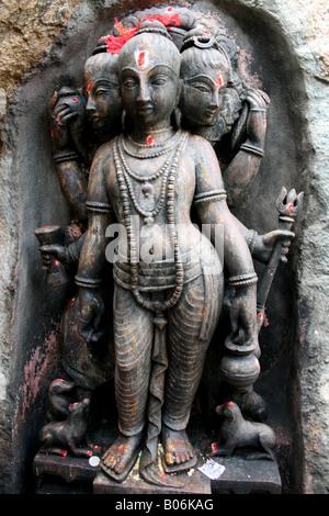 Trimurti temple statue with Brahma , Shiva and Vishnu making the supreme being, India - Stock Photo