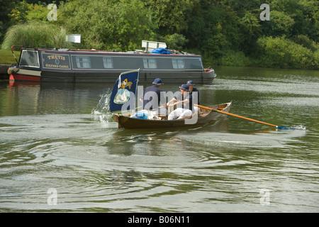 Swan upping on the River Thames boats leaving Bovney Lock Windsor - Stock Photo