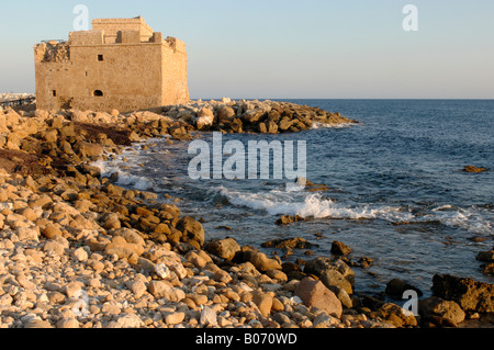 Paphos Castle, originally a Byzantine fort, rebuilt by Lusignans and strengthened by the Ottomans in evening sunshine - Stock Photo