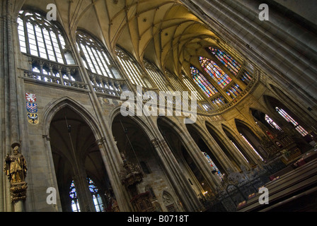 Horizontal abstract wide angle of the altar and vaulted ceiling inside St Vitus's Cathedral. - Stock Photo