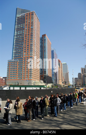 Tourists waiting in the line for the Liberty Island visit to see the Statue of Liberty, New York - Stock Photo