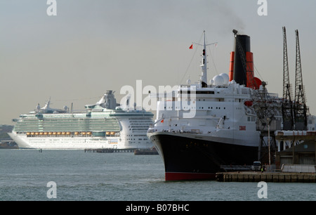 QE2 and Independence of the Seas Old and new Cruise ships Southampton - Stock Photo