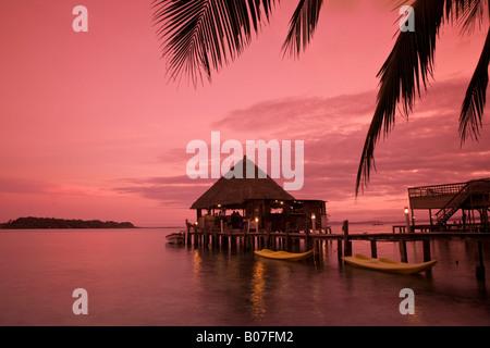 Panama, Bocas del Toro Province, Carenero Island (Isla Carenero), Pickled Parrot restaurant and bar reflects in - Stock Photo