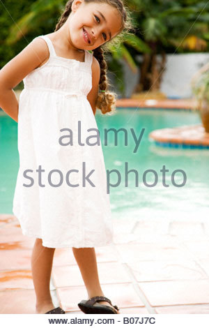 portrait little Hispanic girl by the swimming pool - Stock Photo