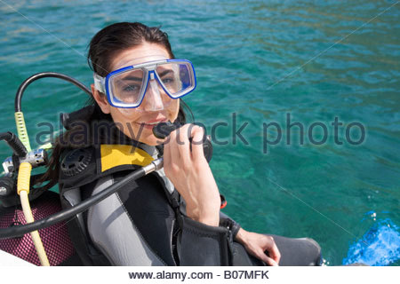 A woman about to go scuba diving - Stock Photo