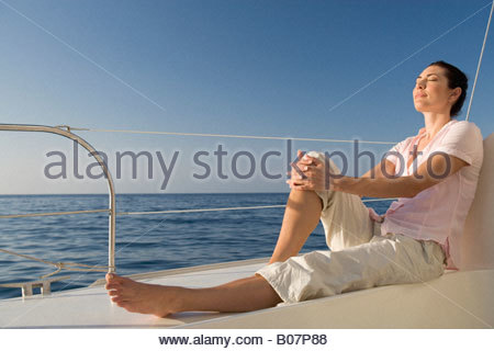 A woman relaxing on a boat - Stock Photo