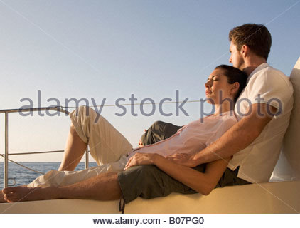 A couple relaxing on a boat - Stock Photo