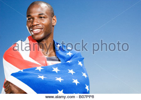Portrait of a male athlete with US flag - Stock Photo