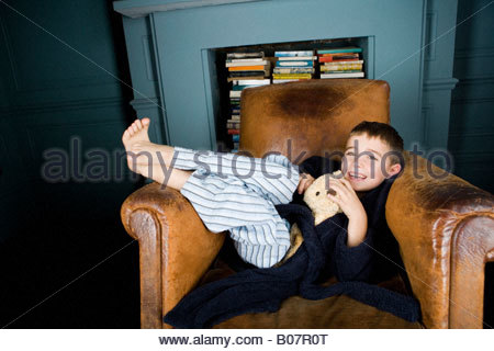 Boy Hugging Teddy Bear In Bed Stock Photo Royalty Free