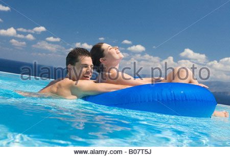 A couple relaxing in a pool - Stock Photo
