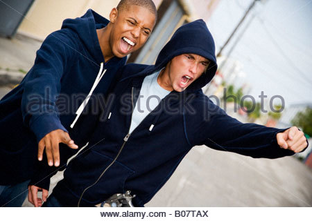 Portrait of two young street gang members - Stock Photo