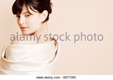 Portrait of elegant young woman in a white silk dress or wrap - Stock Photo