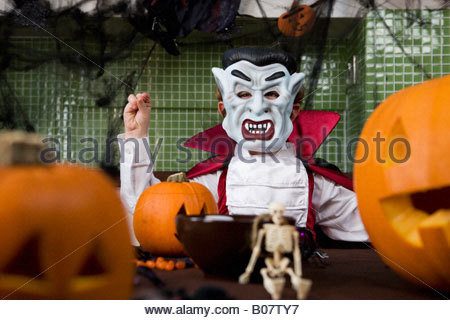 Little boy in a Dracula outfit dressed up for Halloween - Stock Photo