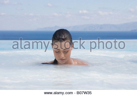 A woman relaxing in a jacuzzi - Stock Photo