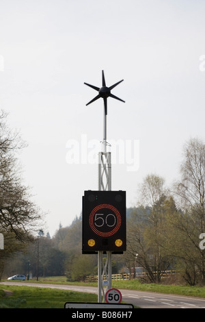 West Sussex England UK Wind powered 50 mph speed sign illuminated on country main road - Stock Photo