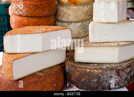 Hand made local cheeses  Flor de Guia made from sheep and goat's milk sold in Sunday market Teror 'Gran Canaria' - Stock Photo