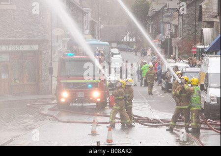A fire being tackled by firemen in Ambleside Cumbria UK - Stock Photo