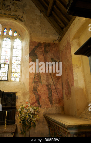 Medieval wall painting of St George and dragon in the chapel of Fairleigh Hungerford castle in Somerset UK - Stock Photo