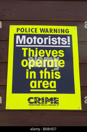 police sign warning of car thieves in the area - Stock Photo