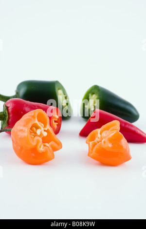 Green Jalapeno, Red Hot Chili Pepper, and Orange Habanero Pepper - Stock Photo