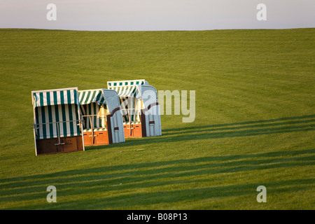 Empty beach chairs on grass, North Frisia, Schleswig Holstein, Northern Germany - Stock Photo