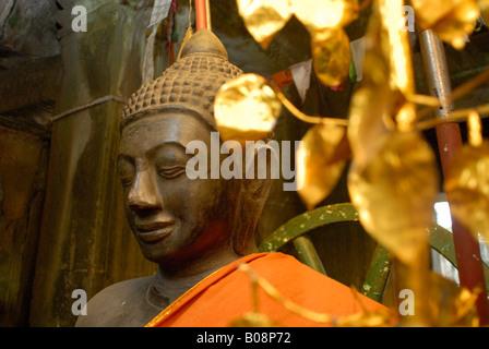 Buddha statue at the Grand Palace in Bangkok, Thailand, Southeast Asia - Stock Photo
