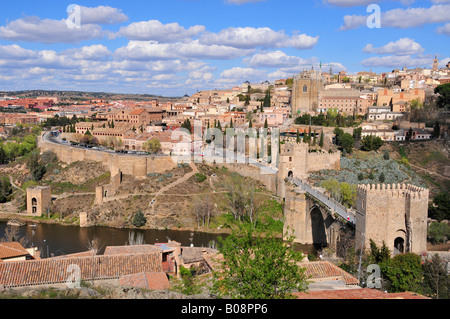 View of the old part of Toledo and the Tajo River, Puente de San Martín in the foreground, Toledo, Spain - Stock Photo