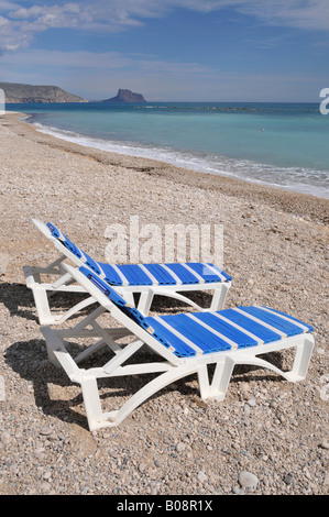 Two empty deck chairs on the beach, Altea, Costa Blanca, Spain - Stock Photo