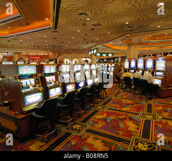 Gamblers sitting in front of slot machines at a casino in Las Vegas, Nevada, USA - Stock Photo