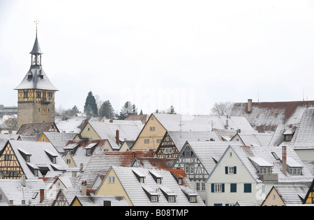 View over snow dusted rooftops, timber framed houses and Upper Gate Tower of the historic centre of Marbach am Neckar, - Stock Photo