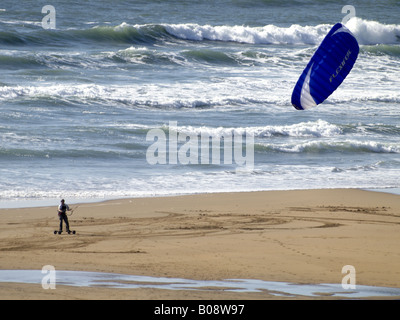 Powerkiter on the smooth sand of Crooklets Beach, Bude, Cornwall, UK - Stock Photo