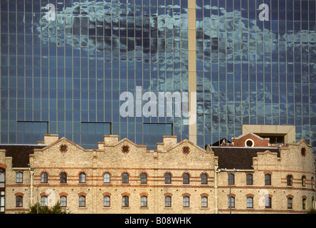Old harbour building in front of modern glass office building, Darling Harbour, Sydney, New South Wales, Australia - Stock Photo