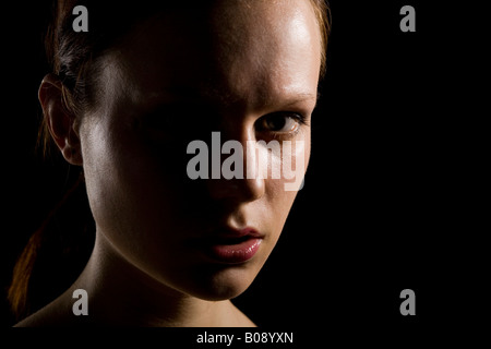 ... Portrait of a young woman strong side lighting shadow - Stock Photo  sc 1 st  Alamy & Portrait of a young woman strong side lighting shadow Stock ... azcodes.com