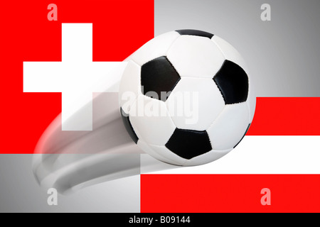Football flying in front of Swiss and Austrian flags - series - Stock Photo
