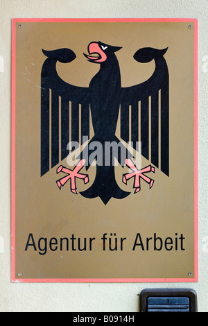 Sign near the entrance of the federal German employment agency - Stock Photo