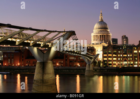 Millennium Bridge and St. Paul's Cathedral seen from the southern bank of the Thames, London, England, UK - Stock Photo