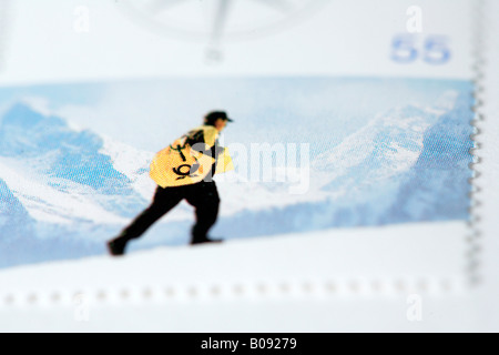 Deutsche Post, German Post postman, mailman in the mountains, stamp theme - Stock Photo