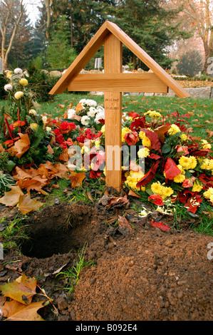 Recently dug-up urn grave at a cemetery in Karlsruhe, Germany