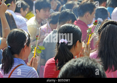 devotins in front temple of the Jade-Buddha statue in Wat Phra Kaeo, big palace, Thailand, Bangkok - Stock Photo