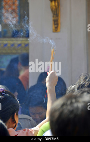 paryers in front temple of the Jade-Buddha statue in Wat Phra Kaeo, big palace, Thailand, Bangkok - Stock Photo