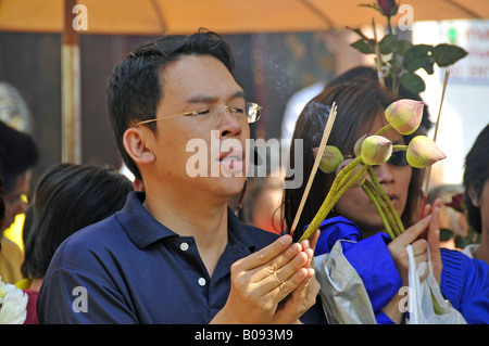 prayers in front temple of the Jade-Buddha statue in Wat Phra Kaeo, big palace, Thailand, Bangkok - Stock Photo