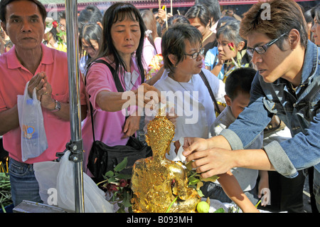 oblation of beaten gold and prayers in front of the temple of Jade-Buddha in Wat Phra Kaeo, big palace, Thailand, - Stock Photo