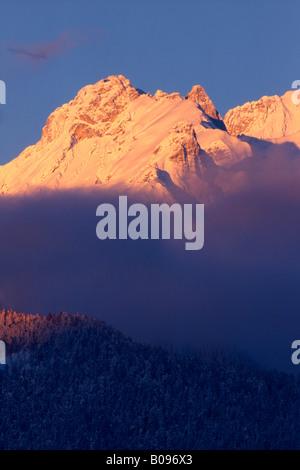 Sunrise over Mt. Bettelwurf seen from Schwaz, Karwendel Range, Tirol, Austria - Stock Photo