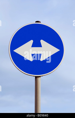 Traffic with a double arrow pointing left and right, looking for direction, directions - Stock Photo