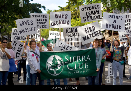 Rally promoting the Sierra Club, with women holding banners promoting environmental issues such as hybrid cars and - Stock Photo