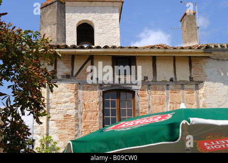 Half timbered House with tower. Tournon d Agenais, Lot et Garonne, France. - Stock Photo
