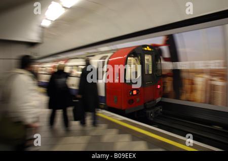 LONDON UNDERGROUND TRAIN APPROACHING STATION - Stock Photo