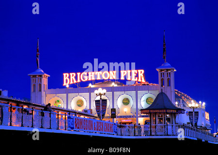 Dramatic Sunset clouds over Brighton Palace Pier Sussex England Britain UK - Stock Photo